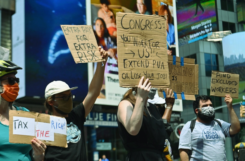 Photo showing protestors demanding economic relief in New York City.