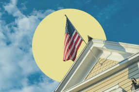 Image showing an American flag on a house, with an article about how veterans can save money when buying a house