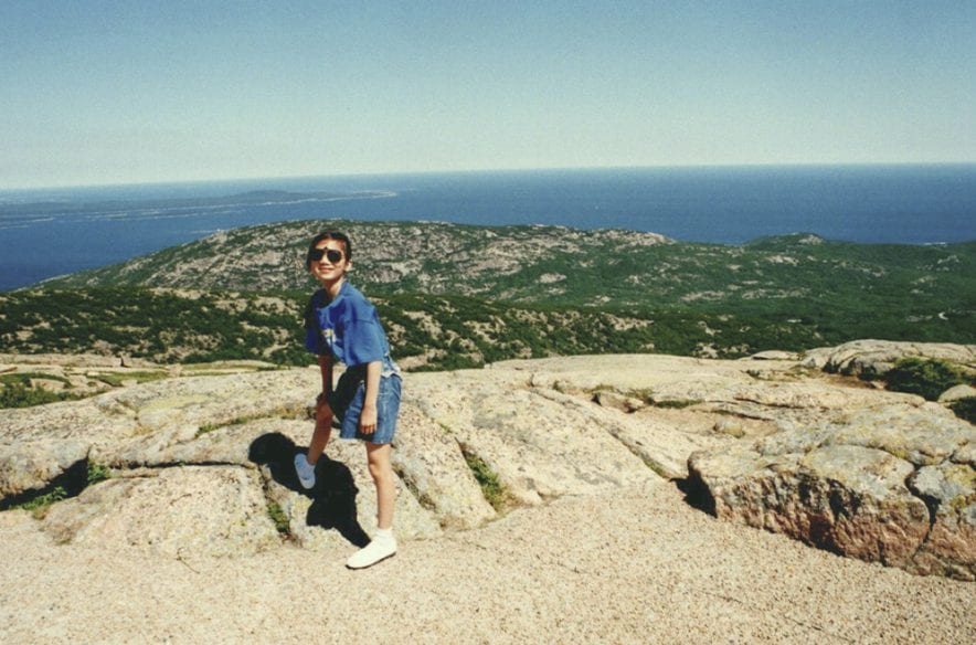 Image caption: A young Shang Saavedra, age 12, at Acadia National Park in Maine.