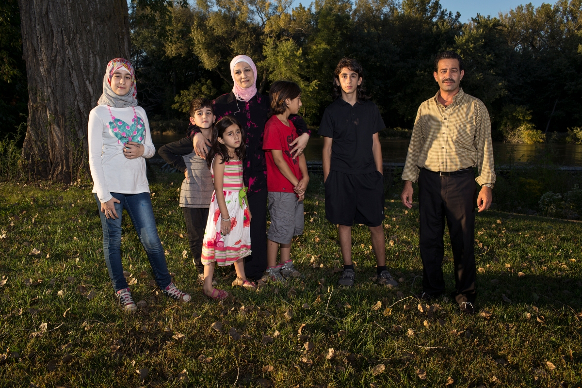 Ghazweh and Abdul Fattah at a park in Des Moines with their children, from left to right: Sedra, Mutaz, Hala, Haidar and Nazeer.
