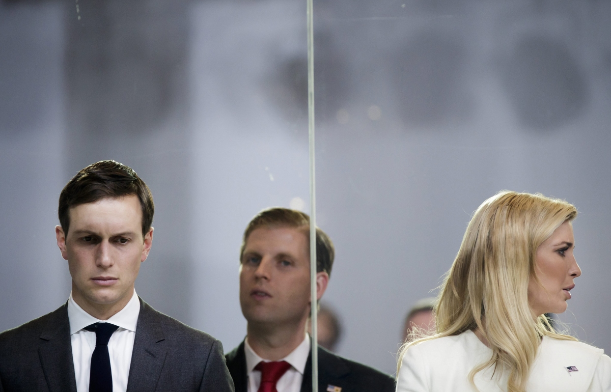 Jared Kushner, senior advisor and son-in-law to President Donald Trump, Eric Trump and Ivanka Trump watch the Inaugural Parade in Washington, D.C., on Jan. 20, 2017.