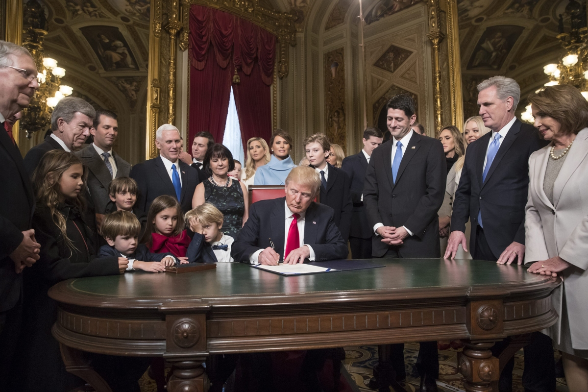 President Trump is joined by the Congressional leadership and his family as he formally signs his cabinet nominations into law in the President's Room of the Senate in Washington, D.C., on Jan. 20, 2017.
