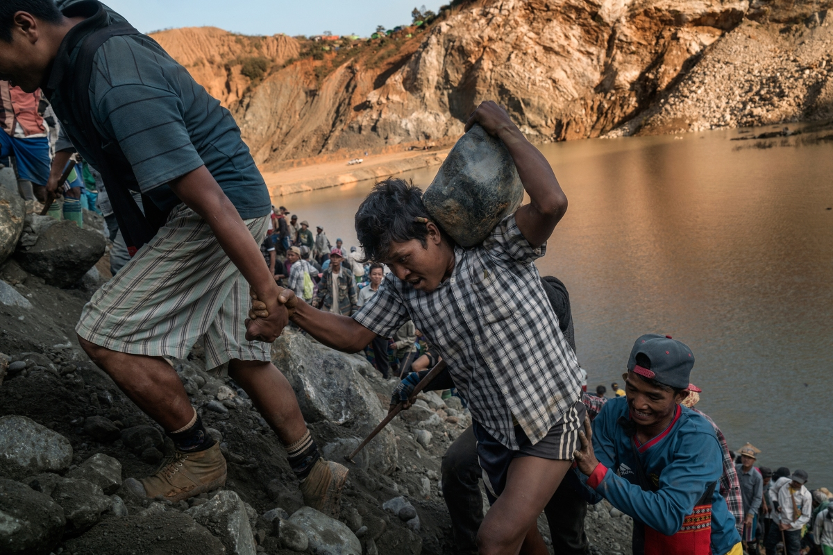 Miners find a jade stone among the discarded tailings at a Hpakant quarry; the slopes are dangerous, and deadly landslides often occur.