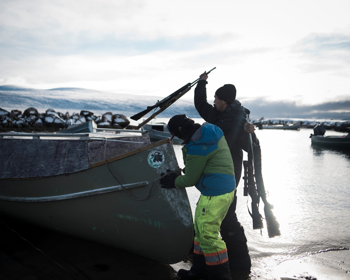 Nanasi and Markoosi, residents of Clyde River, getting ready to go out Norwhal hunting.
