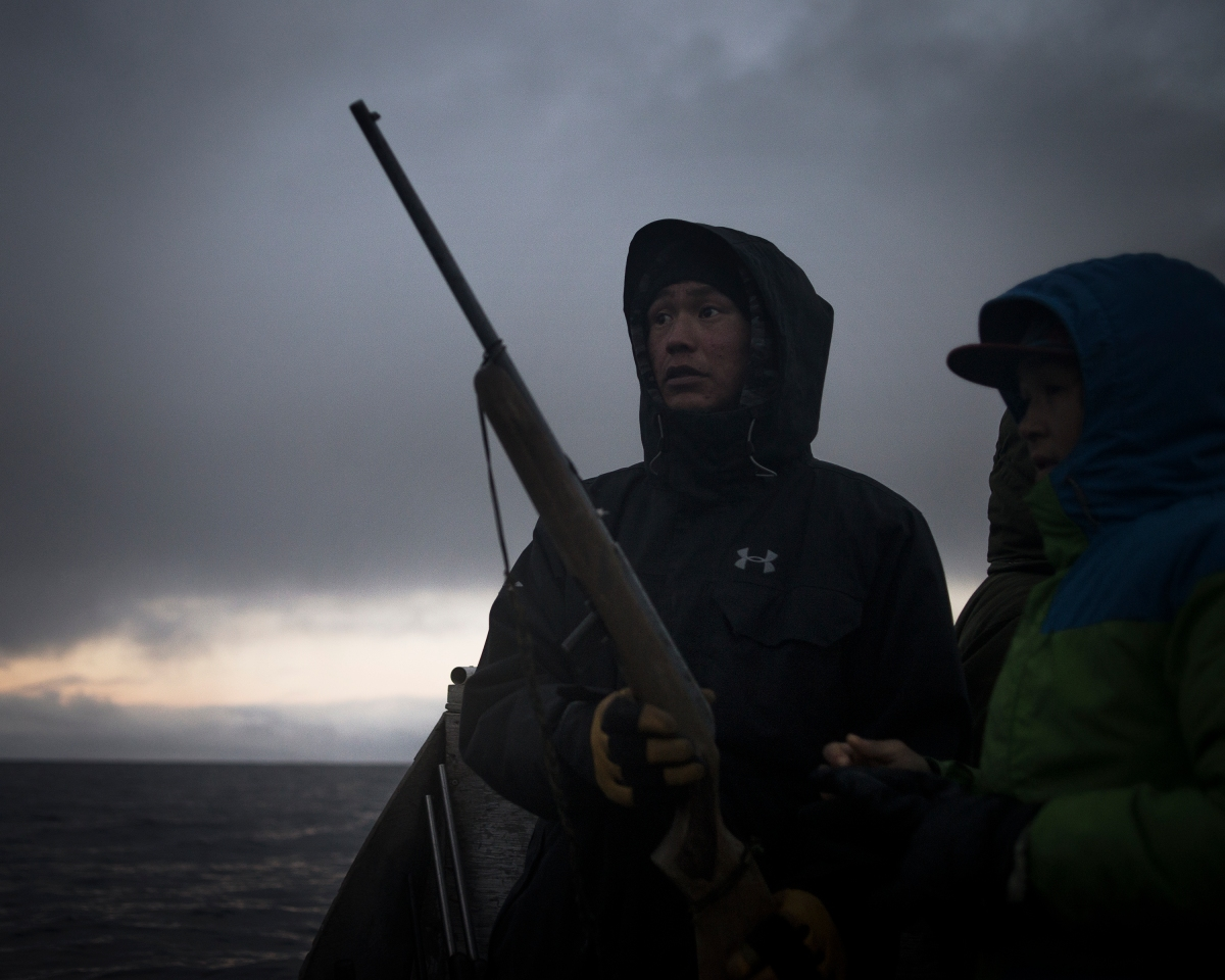 "Nanasi Illauq, 26, and Markoosi Illauq, 15, scanning the water for seals. They grew up with hunting in the family.Nanasi has lost two of his older brothers to suicide, both at the age of 28. The family says there were no warning signs in either case. Traditionally people seek guidance and help from the well-respected elders when they feel lost or depressed. Today the community organization Ilisaqsivik also offers many forms of mental health services. But for Nanasi, hunting is one of the few things that makes him feel better. He caught his first seal when he was 12. ""I was the proudest boy in the world,"" he says, explaining that the hunting tradition gives him peace because it allows him ""to be alone, where there's nobody around to make me mad or make me depressed."""