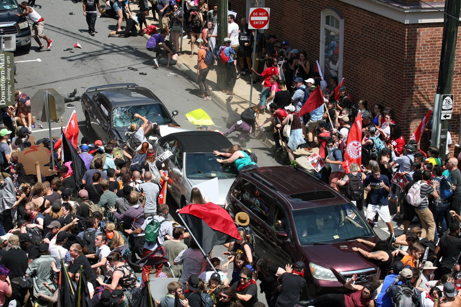 A gray car plows into pedestrians and vehicles as anti-white nationalism counter-protesters were marching through downtown Charlottesville, Va., on Aug. 12. The driver hit the knot of cars and people at high speed, then backed up and fled the scene.